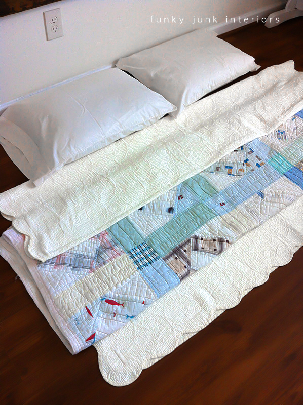 Vintage hand sewn quilt and bedspread via Funky Junk Interiors