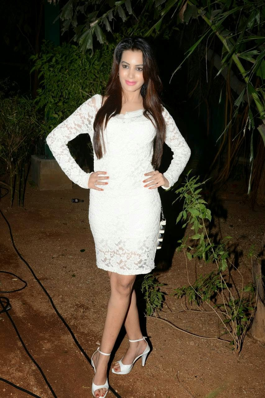 Actress Diksha Panth Unseen Audio Launch Stills, Actress Diksha Panth Crossleg Sitting Pics in White Dress from Event