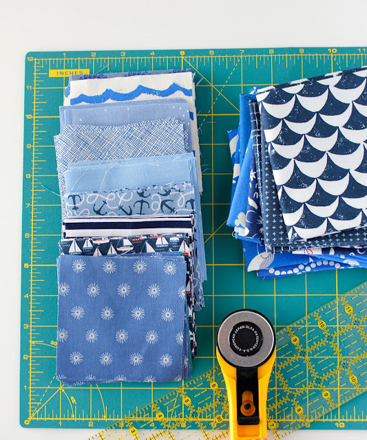 Fun stack of blue fabrics for a nautical patchwork quilt