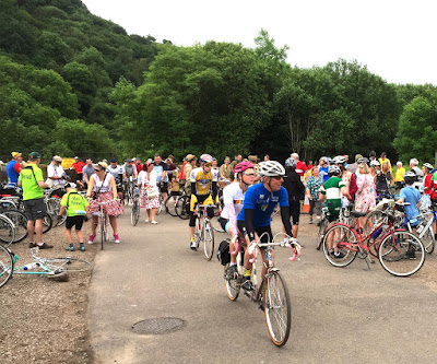 Riders setting off from a brief stop at Mill Dale Station