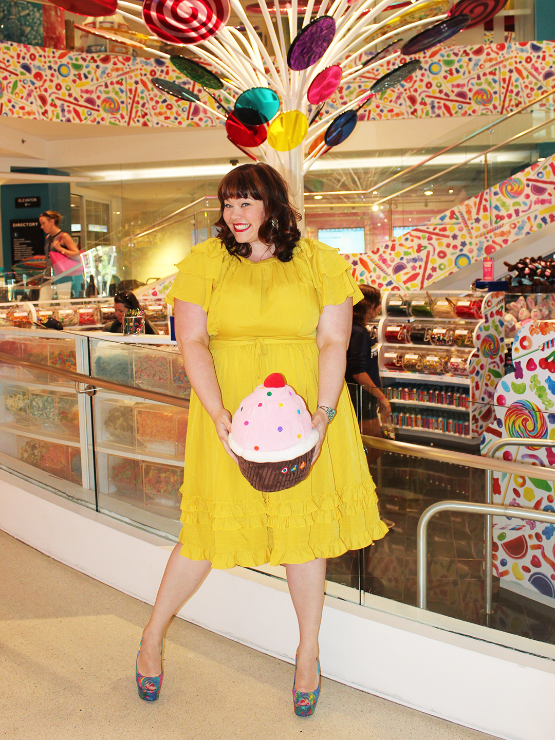 Plus Size Blogger Amber from Style Plus Curves in a Yellow Eloquii Ruffled Dress, yellow dress, plus size model, plus size fashion, ruffled dress, candy