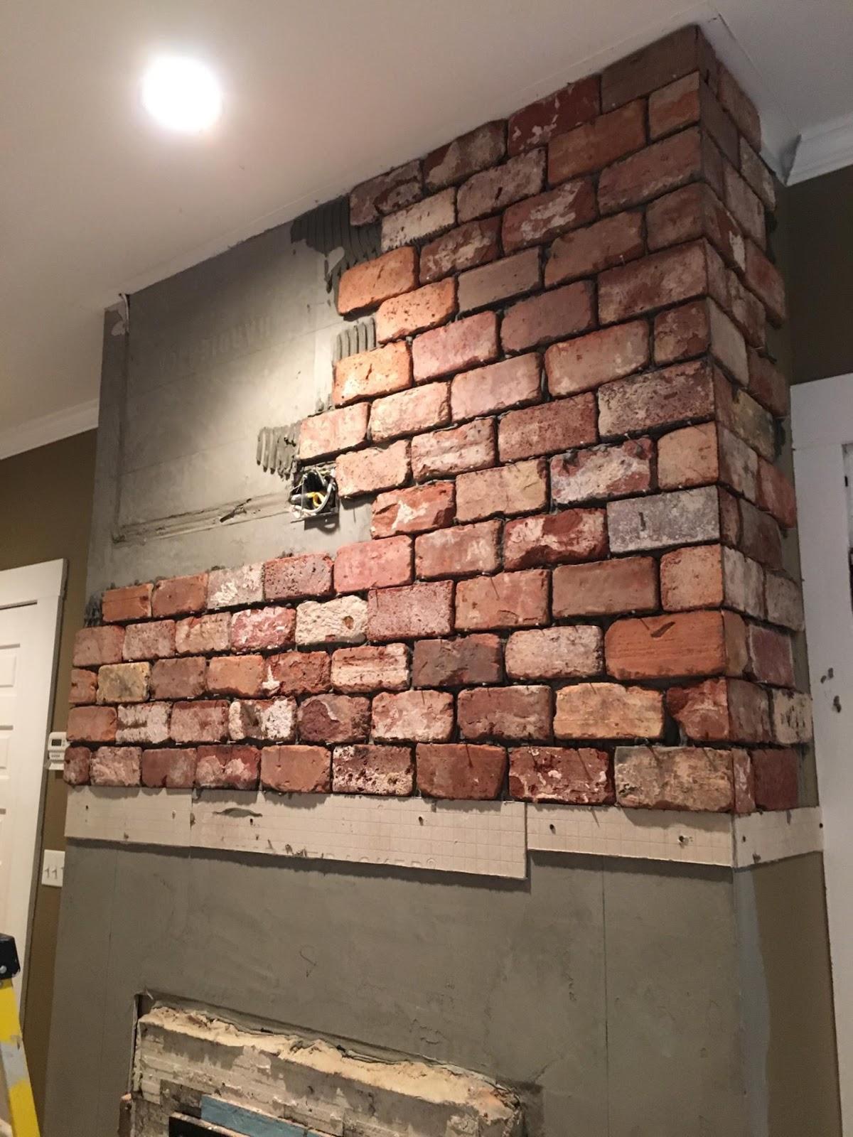 Reclaimed thin brick tiles fireplace www.vintagebricks.com