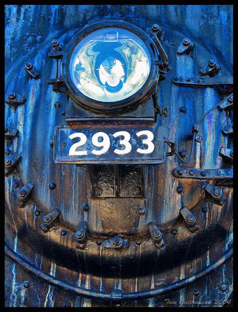 The headlight and number plate on the streaked front of NYC 2933 at the National Museum of Transportation.