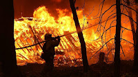 Fierce wildfires are burning through Northern and Southern California - destroying buildings and forcing more than 250,000 residents to flee.  (Credit: Getty Images) Click to enlarge.