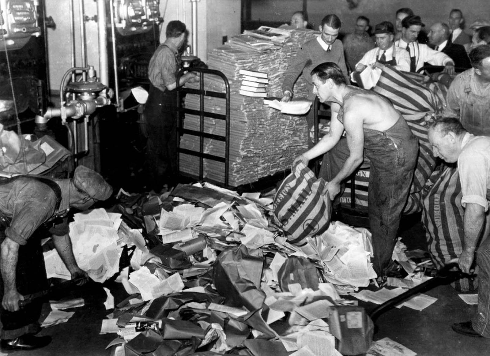 U.S. Postal employees feed 17 tons of reading matter, labeled by postal authorities as propaganda, into a furnace in San Francisco, California, on March 19, 1941. The bulk of the newspapers, books, and pamphlets came from Nazi Germany and some from Russia, Italy and Japan.
