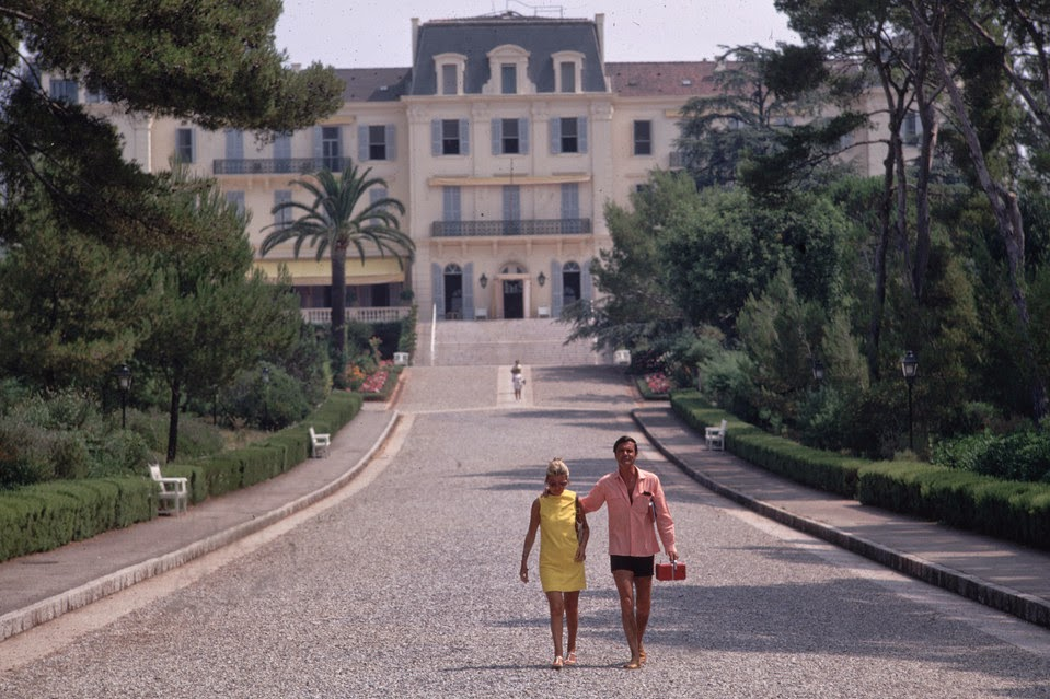 Louis Jourdan And His Wife Photographed By Slim Aarons In 1969 While Strolling Around The Hotel Du Cap Eden Roc Antibes
