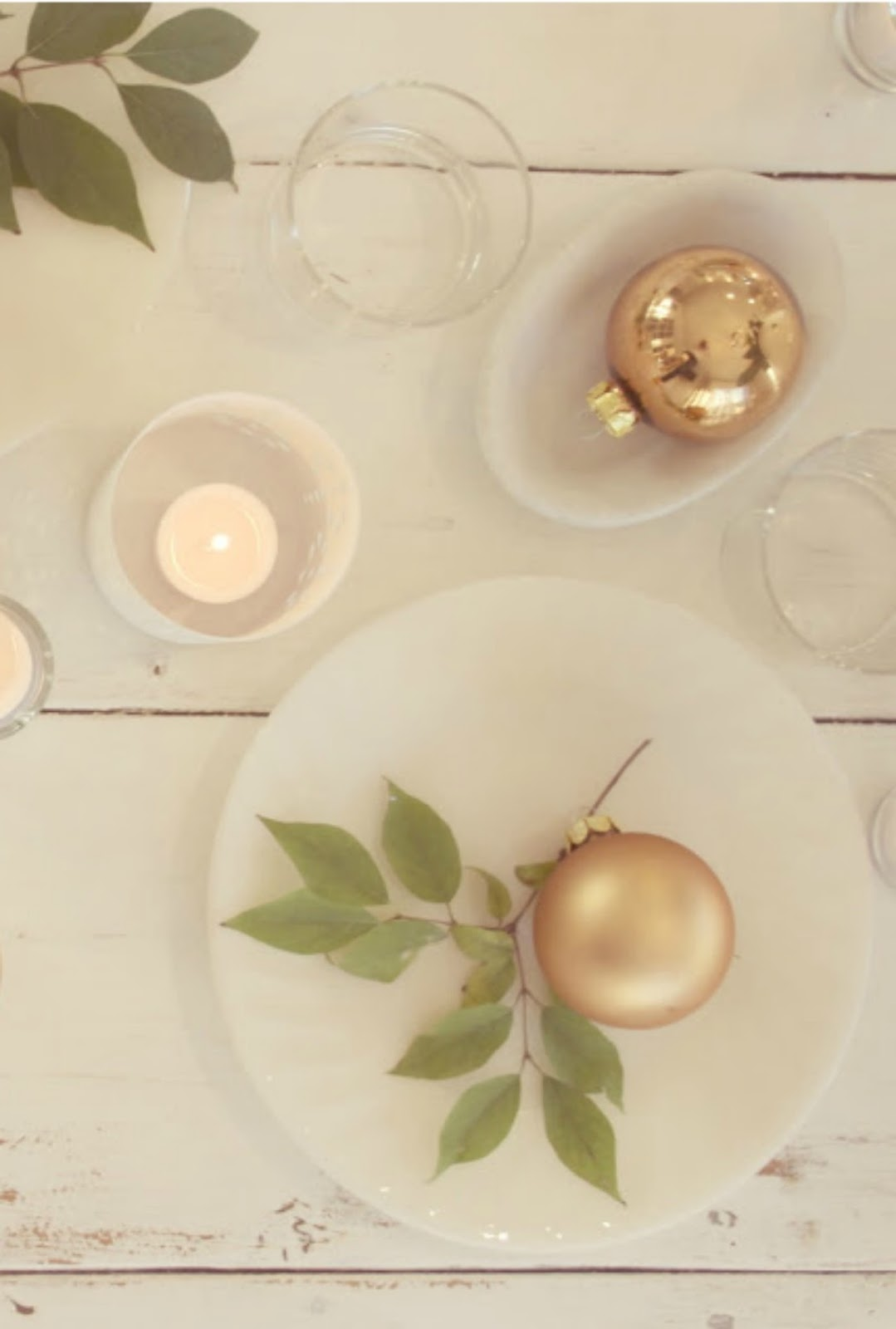 White milk glass, gold ball ornaments, and fresh greenery for modern #farmhouseChristmas tablescape by Hello Lovely Studio