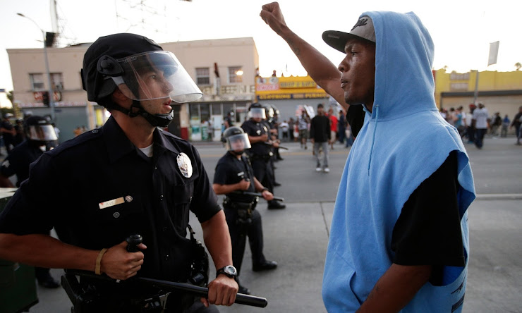 protester confronts police after acquittal of Trayvon Martin's killer in 2013