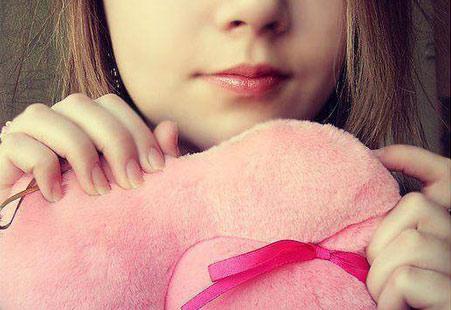 girl hidden face with teddy bear