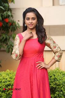 Sri Divya Stills in Red Dress at Kaashmora Press Meet