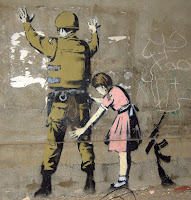 Bethlehem Wall Graffiti girl frisks soldier