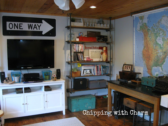 Chipping with Charm: Family Room Redo...Pipe shelves www.chippingwithcharm.blogspot.com