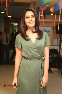 Actress Raashi Khanna Stills in Green Short Dress at Mirchi 95 Suno Aur Mercedes Jeeto Contest  0070.JPG