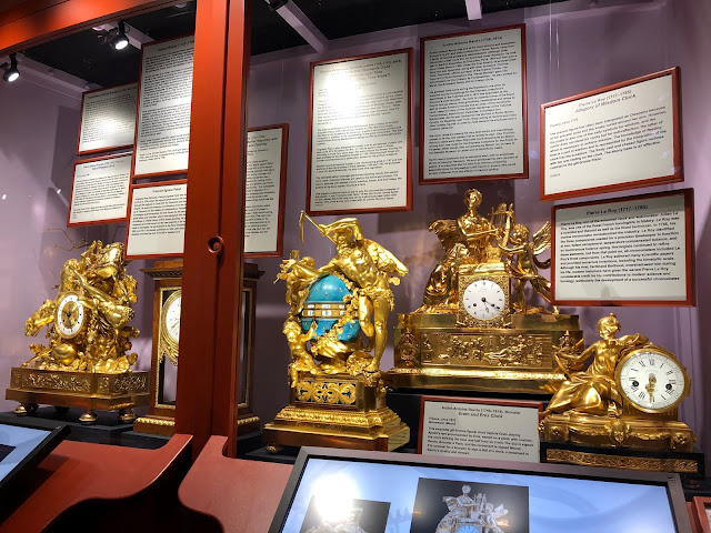 Ornate French clocks. The clock in the center is called The Triumph of Love Over Time. Halim Museum of Time and Glass