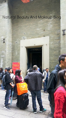 Entrance of Lou Kau Mansion near Cathedral Square, Macau. Showing visitors and the gate