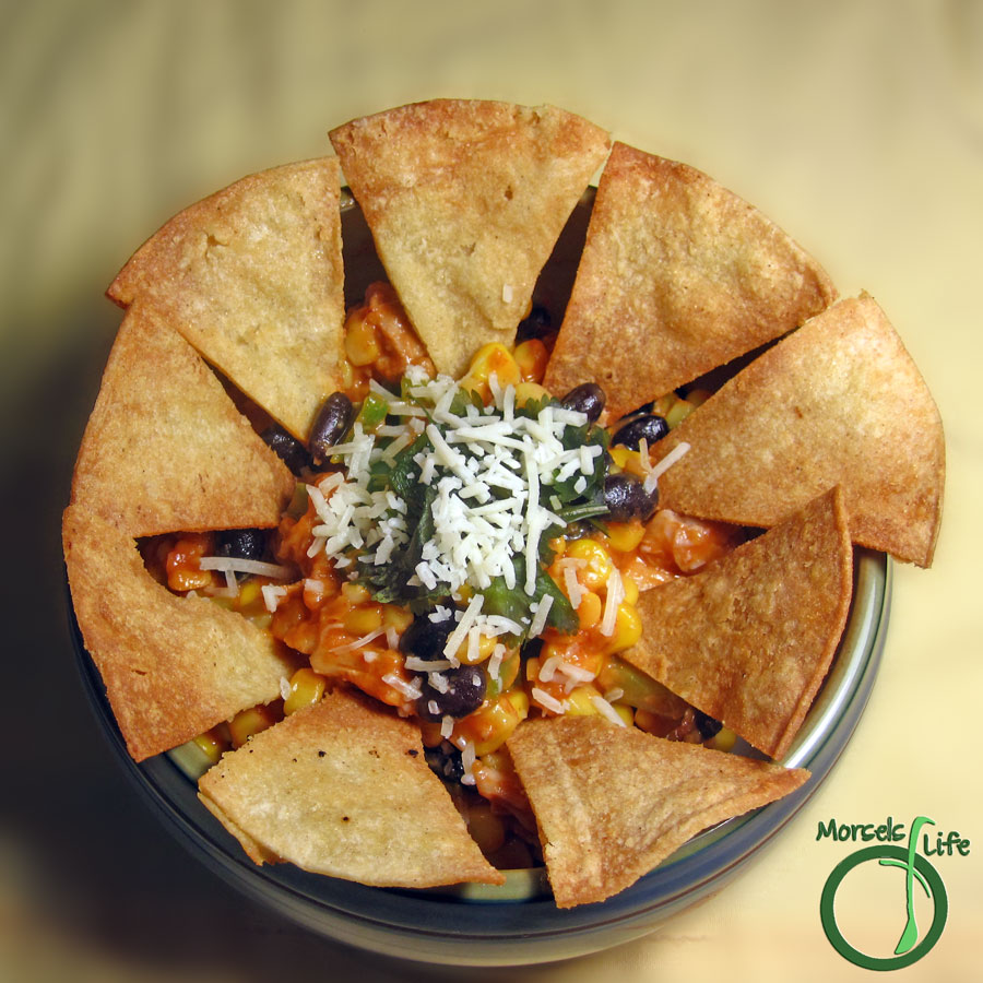 Morsels of Life - Skillet Chicken Nachos - A filling dip with creamy beans, sweet crisp vegetables, and delectable chicken all enveloped in velvety cheeses.