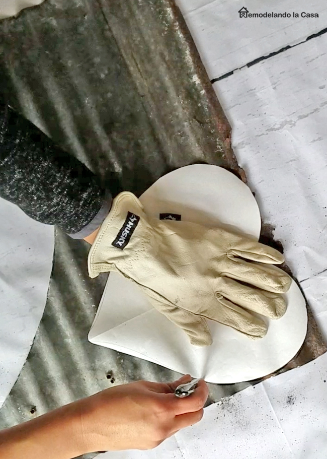 tracing a heart shape on tin with Sharpie and Husky leather gloves