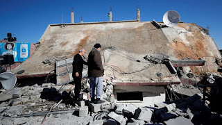 The Israeli army has demolished a residential building owned by a Palestinian woman whose five sons have all been imprisoned by Israel.