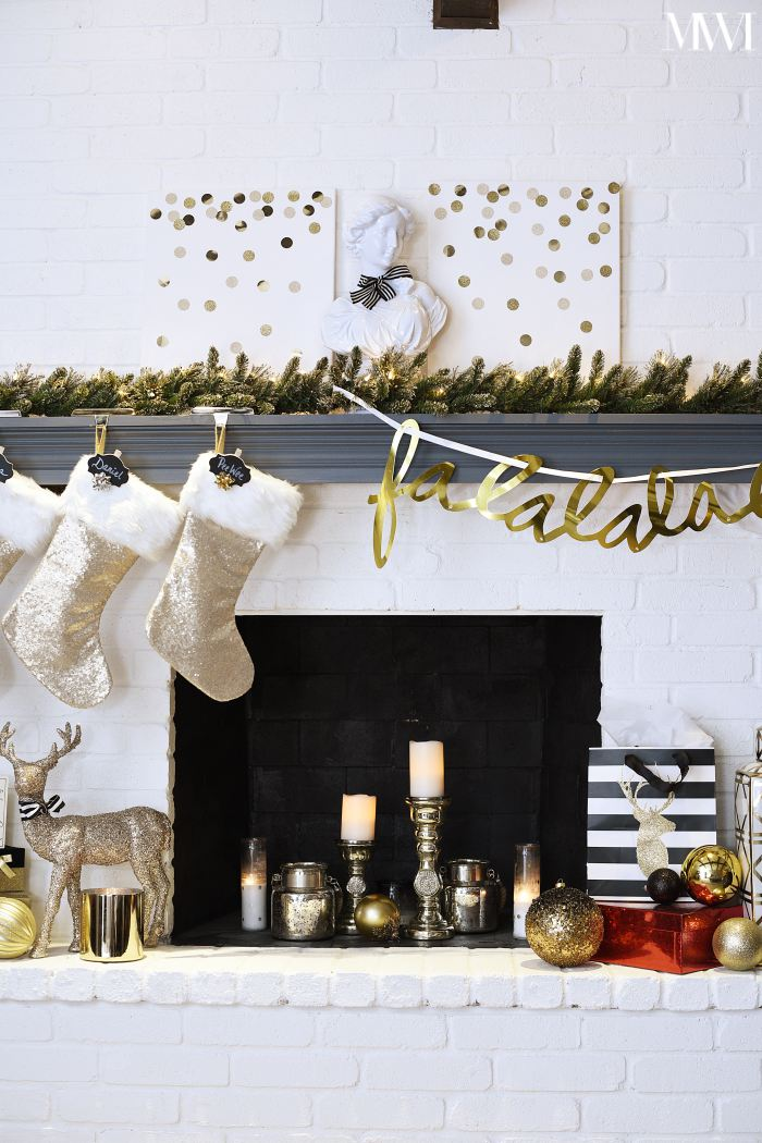 Gold sequin stockings on a Christmas mantel
