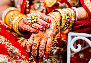 The Bengali brides wear red, maroon, pink color saree on their wedding day.