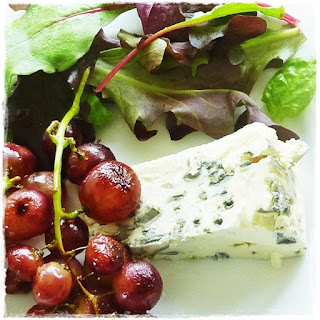 blue cheese with sauteed grapes