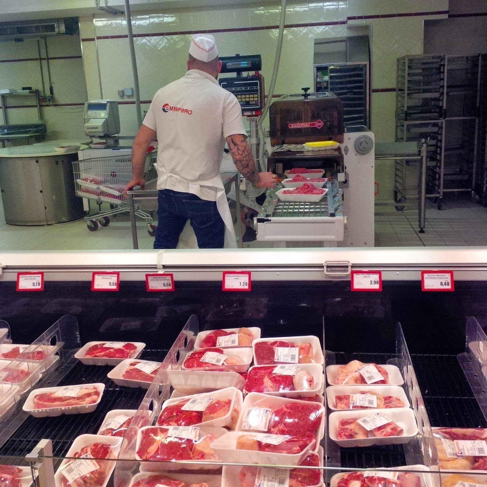 Observing a butcher at work packing large packs of mince meat