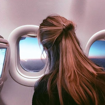 a-blonde-girl-on-the-plane-to-new-york