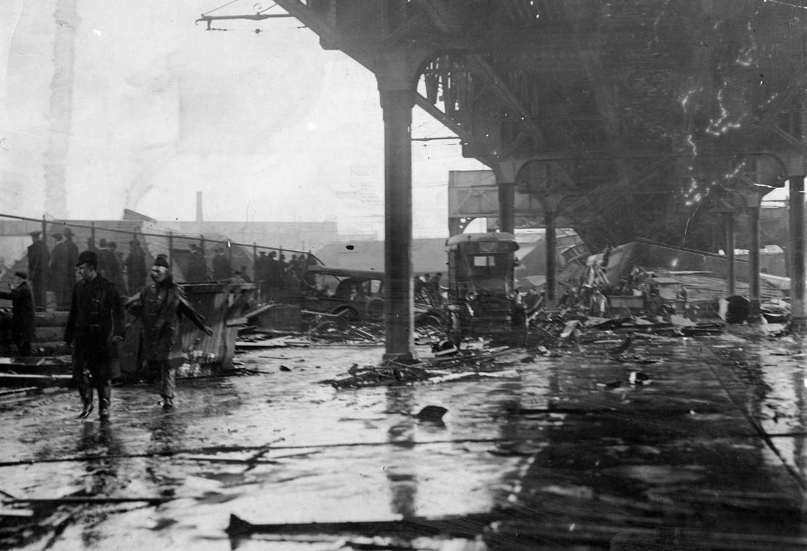Debris, including smashed vehicles, lined Commercial Street the day of the collapse and flood. When the temperature plunged overnight, the dead became entombed in the hardened sugar.