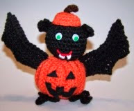 http://www.ravelry.com/patterns/library/pumpkin-spider-and-pumpkin-bat#