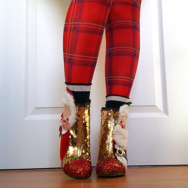 front legs wearing red tartan tights and Christmas themed ankle boots