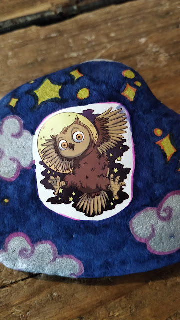 augmented reality owl sticker on decorated rock