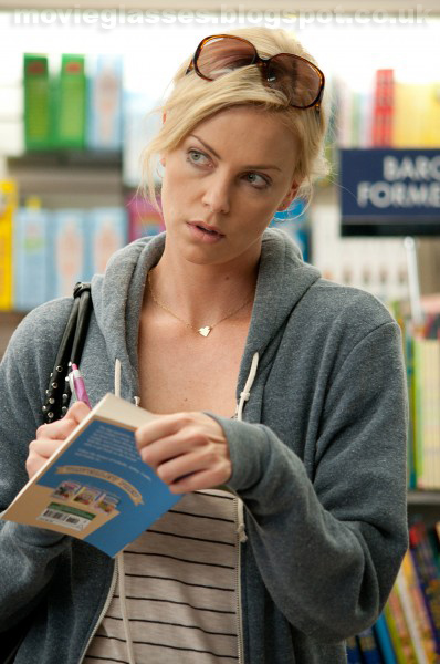 Charlize Theron in Young Adult wearing Dior Sunglasses and signing her book in a book store