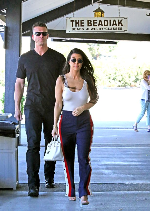 Kourtney Kardashian Goes Braless Under See Through White Top On