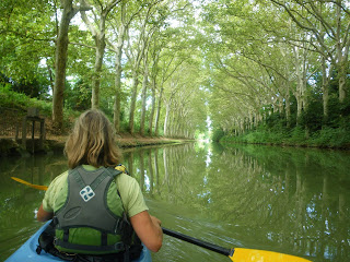 Kri Kri Studio owner in plane tree tunnel, Canal du Midi France, Nigel Foster