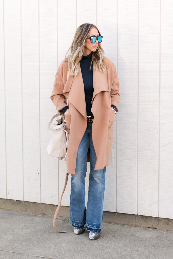 beige wrap coat flare jeans turtleneck parlor girl