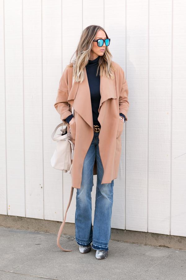 beige wrap coat flare jeans turtleneck parlor girl