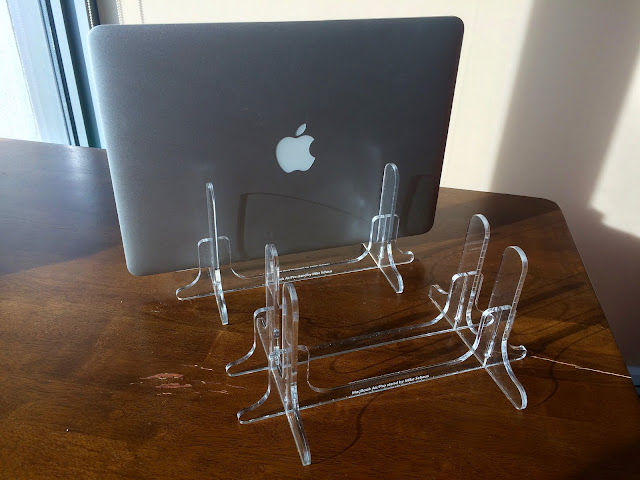 The two copies of the laptop stand I cut out of acrylic