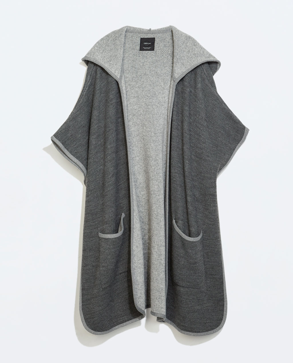 http://www.zara.com/uk/en/woman/knitwear/cardigans/hooded-cape-with-piping-c498027p2252501.html