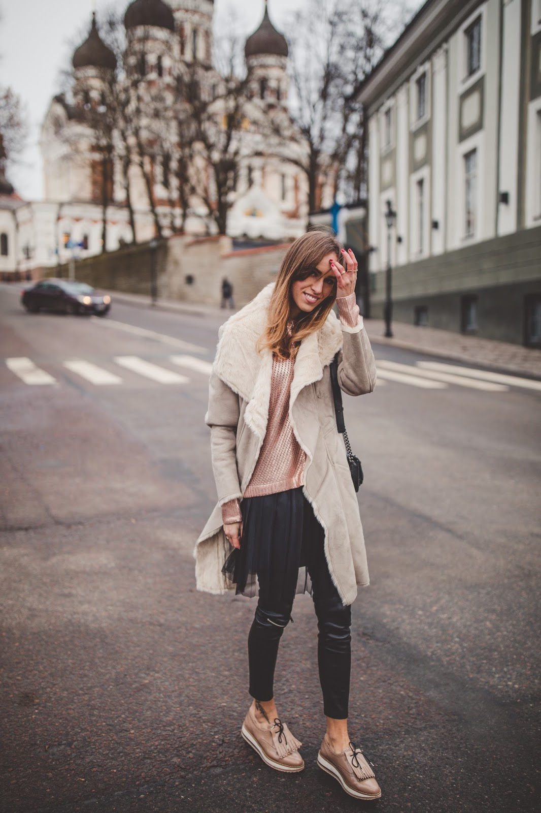 shearling coat dress over leather pants fall street style