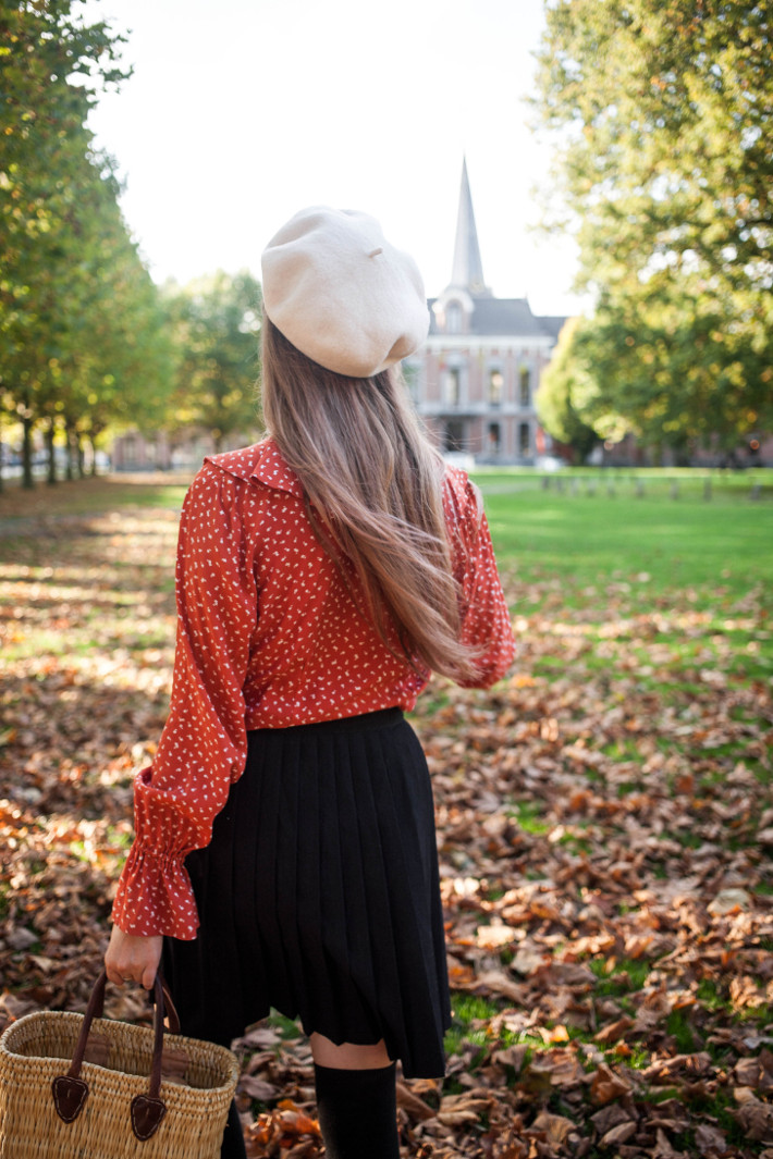 vintage fall outfit in ruffled blouse, knife pleated skirt and overknee socks