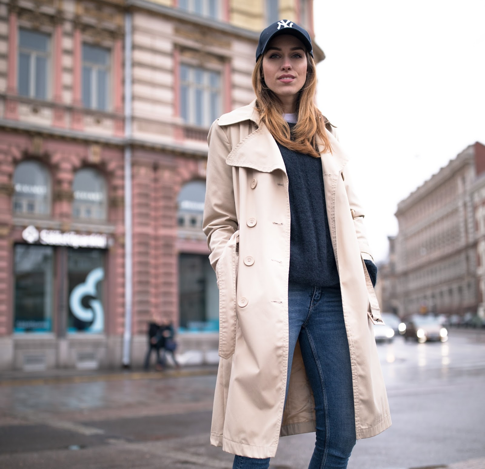 beige long trench coat cap outfit