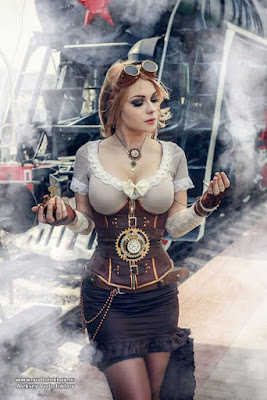 An example of how corsets are used in women's Steampunk fashion. This woman is wearing her underbust corset with a mini skirt, short sleeved top, fingerless gloves, a belt and goggles.