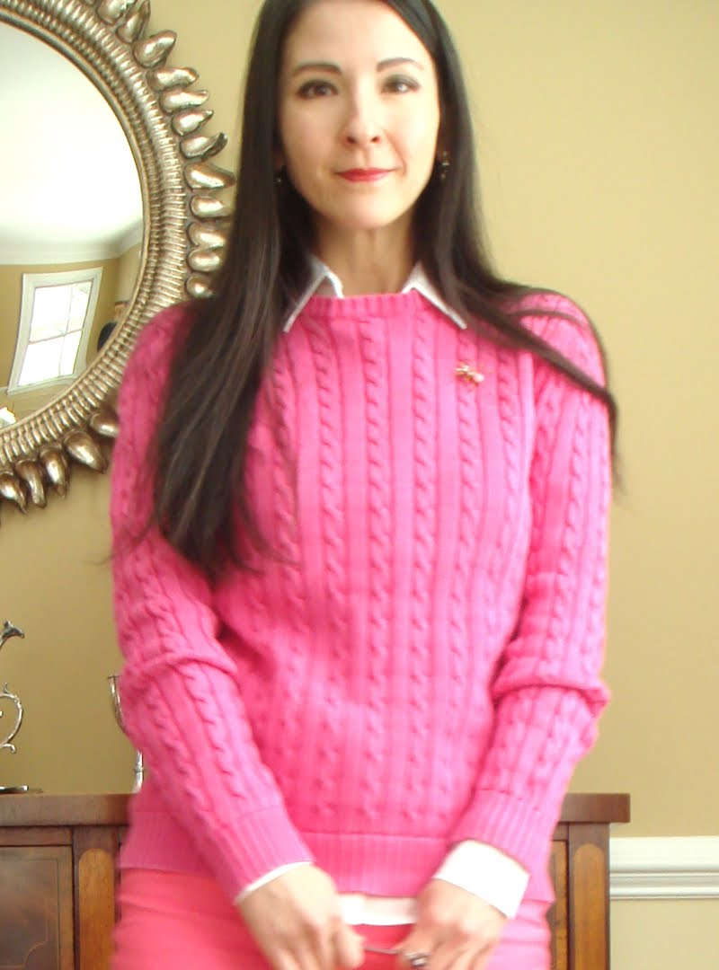 All pink outfit top half of body facing forward.