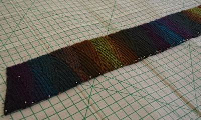Shadow Spectrum scarf pinned onto the blocking board. The grid is in inches.