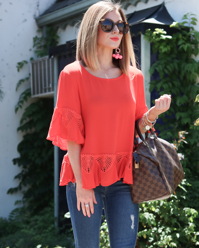 Orange top with a louis vuitton speedy 30.