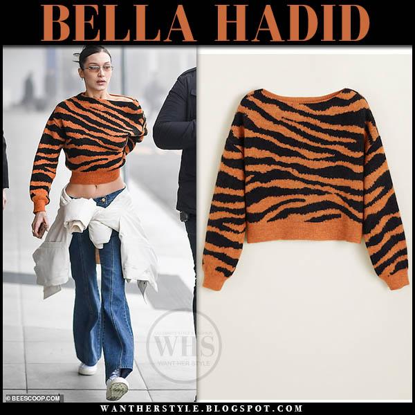 3b802b3bd1 Bella Hadid wearing orange cropped tiger print sweater from Mango Milan  fashion week outfits february 2019