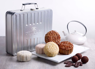 Source: Crowne Plaza Changi Airport. A tin suitcase will house four pieces of mooncakes.
