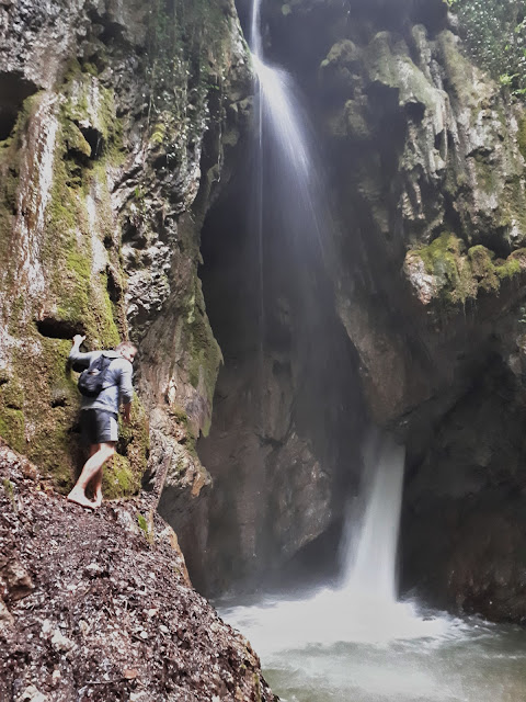 The Social Traveler at the Gorg d'Abiss waterfall in Valle di Ledro, Trentino