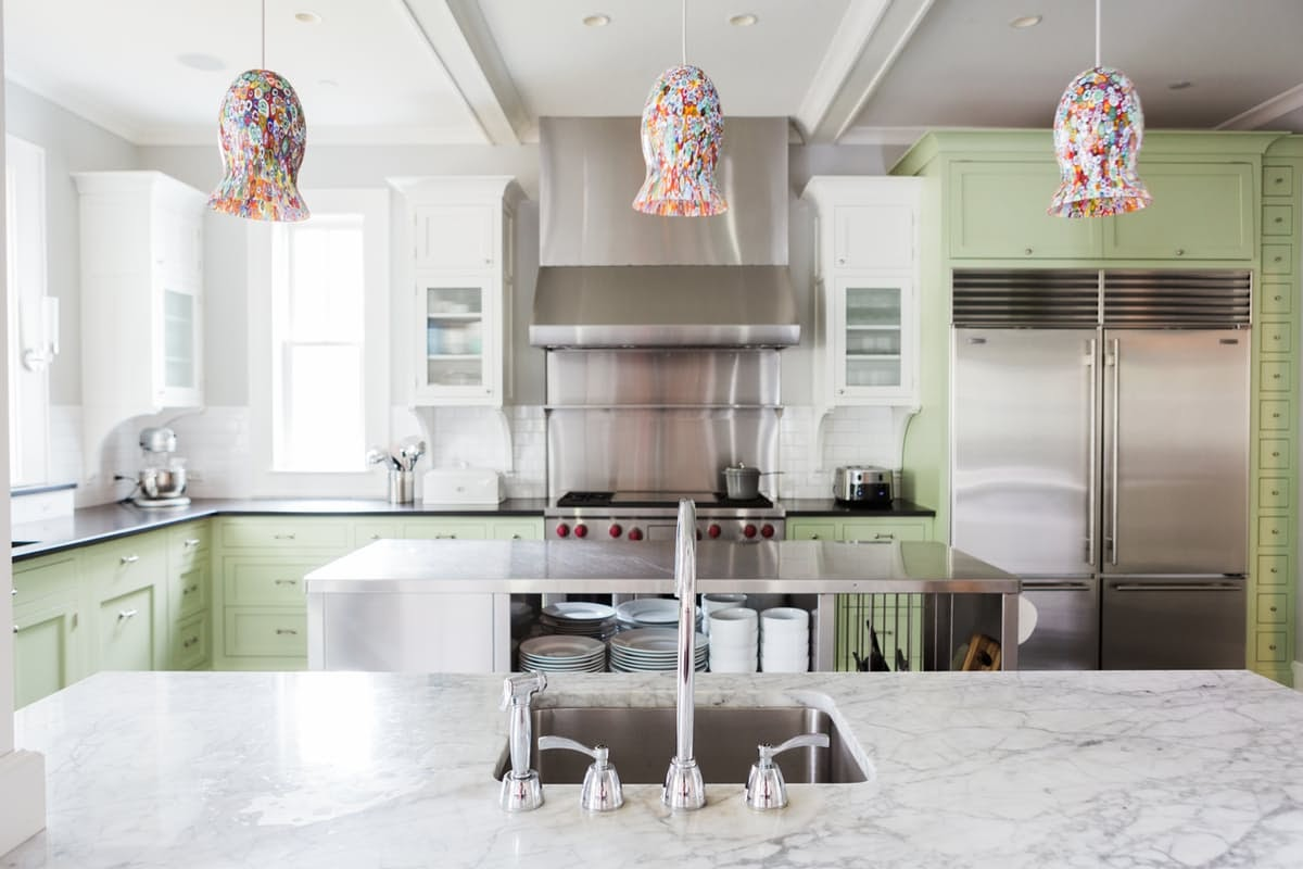 Modern farmhouse kitchen with bright green cabinets on Hello Lovely Studio