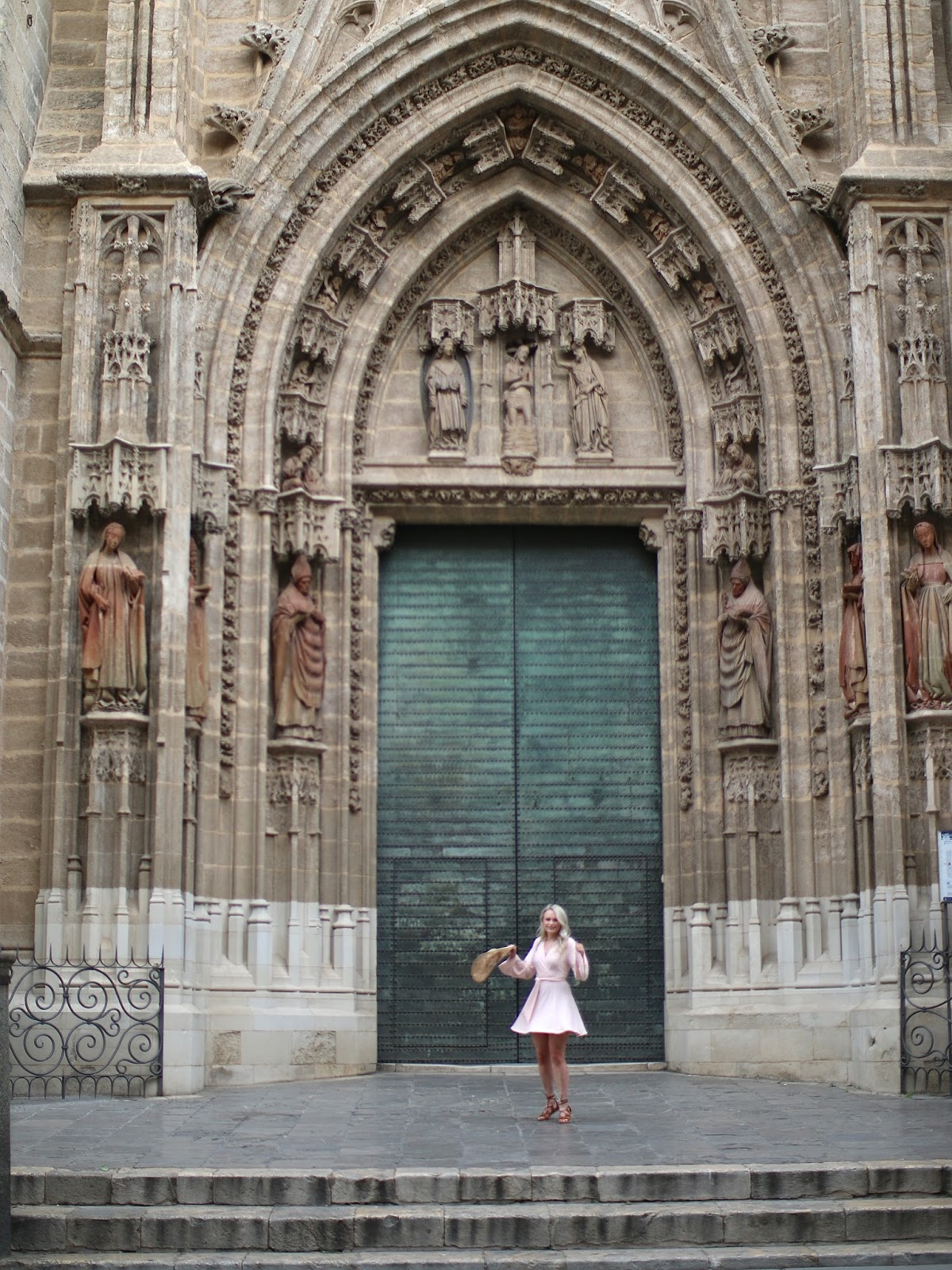 twirling in front of cathedral in spain